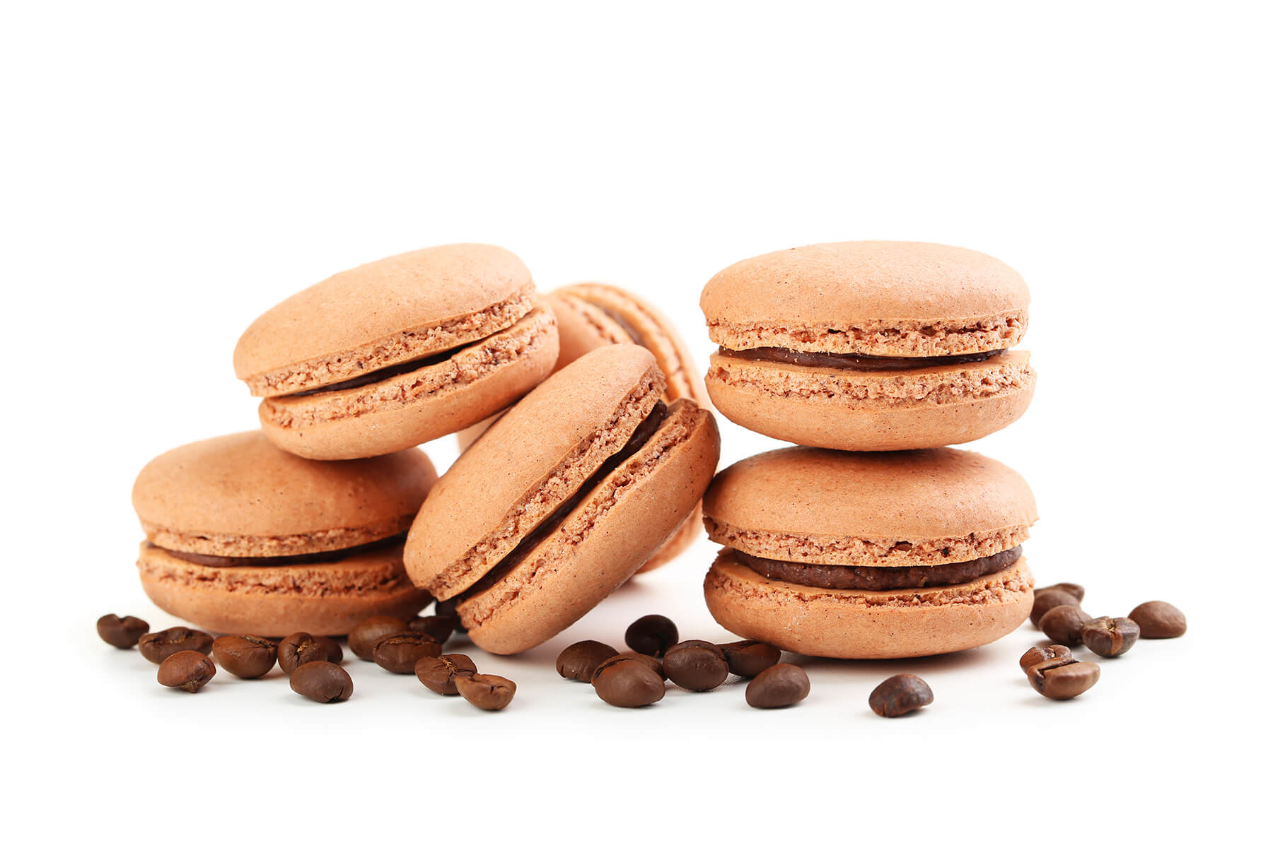 Tasty coffee macarons with coffee beans isolated on white